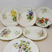 A 19th century dessert service, comprising four comports and twelve plates, decorated flowers, 23 cm