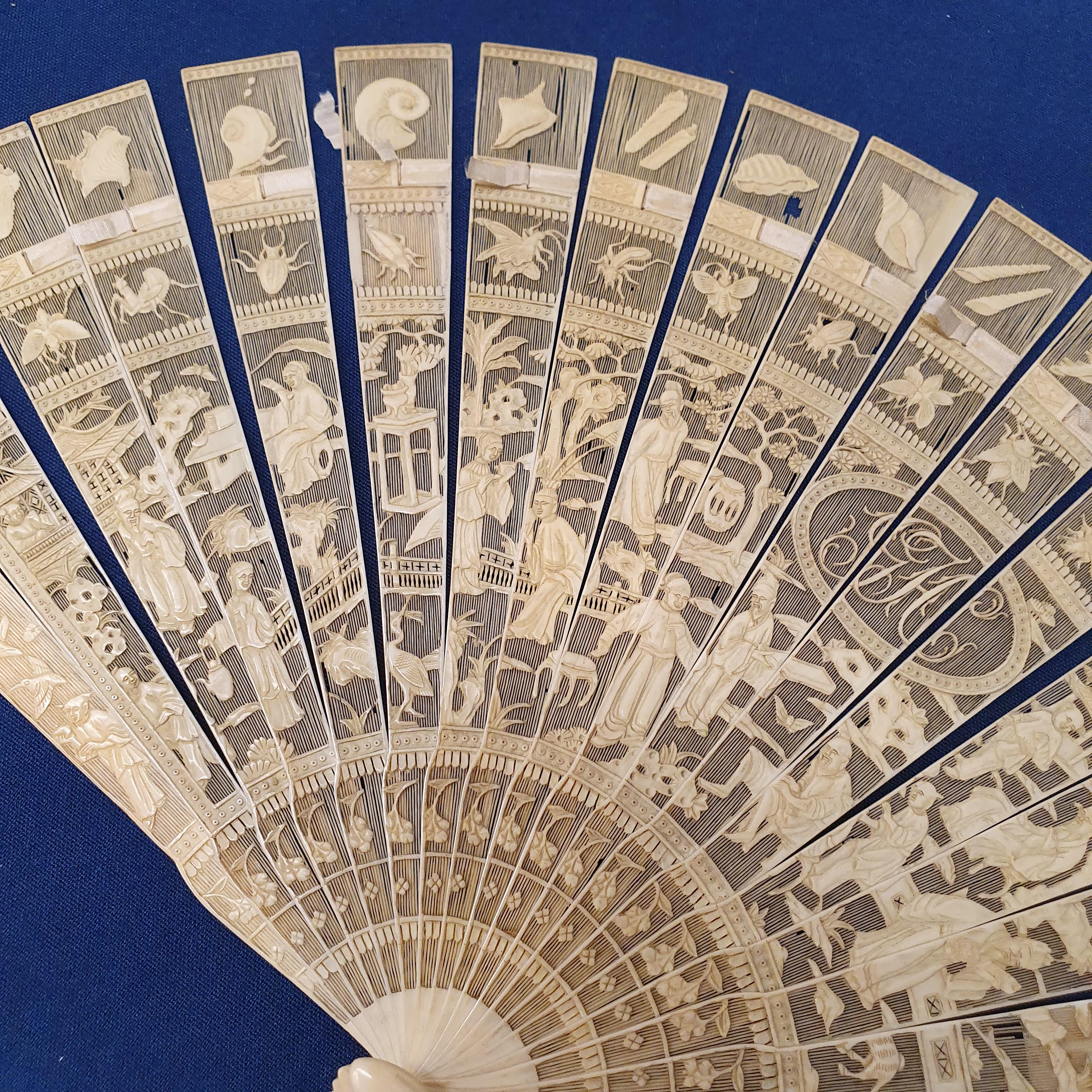 A Chinese ivory brisee fan, two others, and a similar fan with silk embroidered decoration, in a - Image 8 of 47