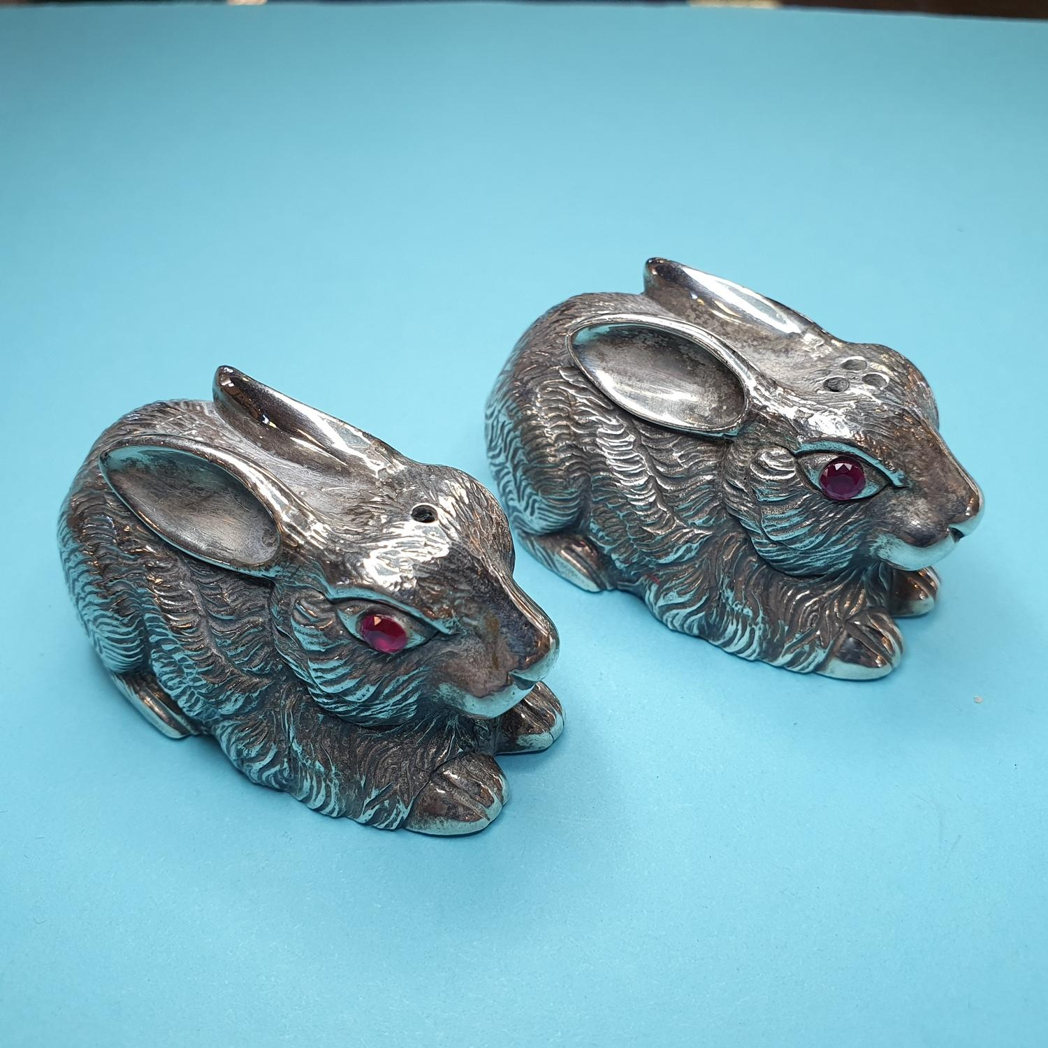 A pair of novelty silver condiments, in the form of rabbits