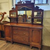 An early 20th century mahogany sideboard, with a mirrored back, the a base with three drawers