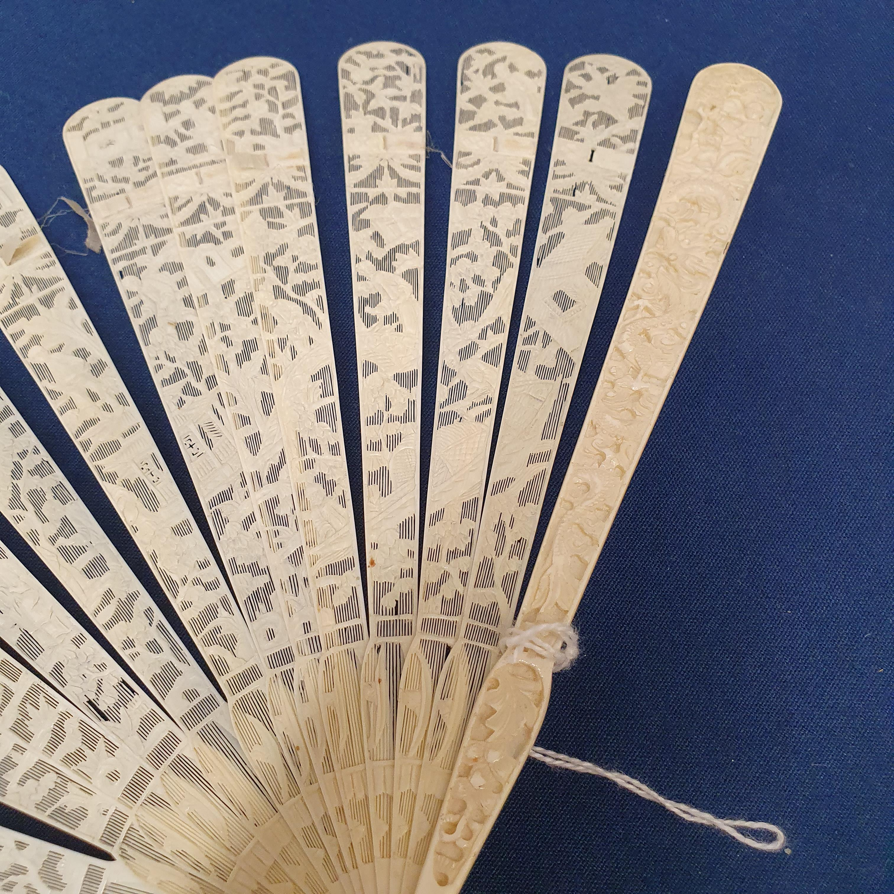 A Chinese ivory brisee fan, two others, and a similar fan with silk embroidered decoration, in a - Image 37 of 47