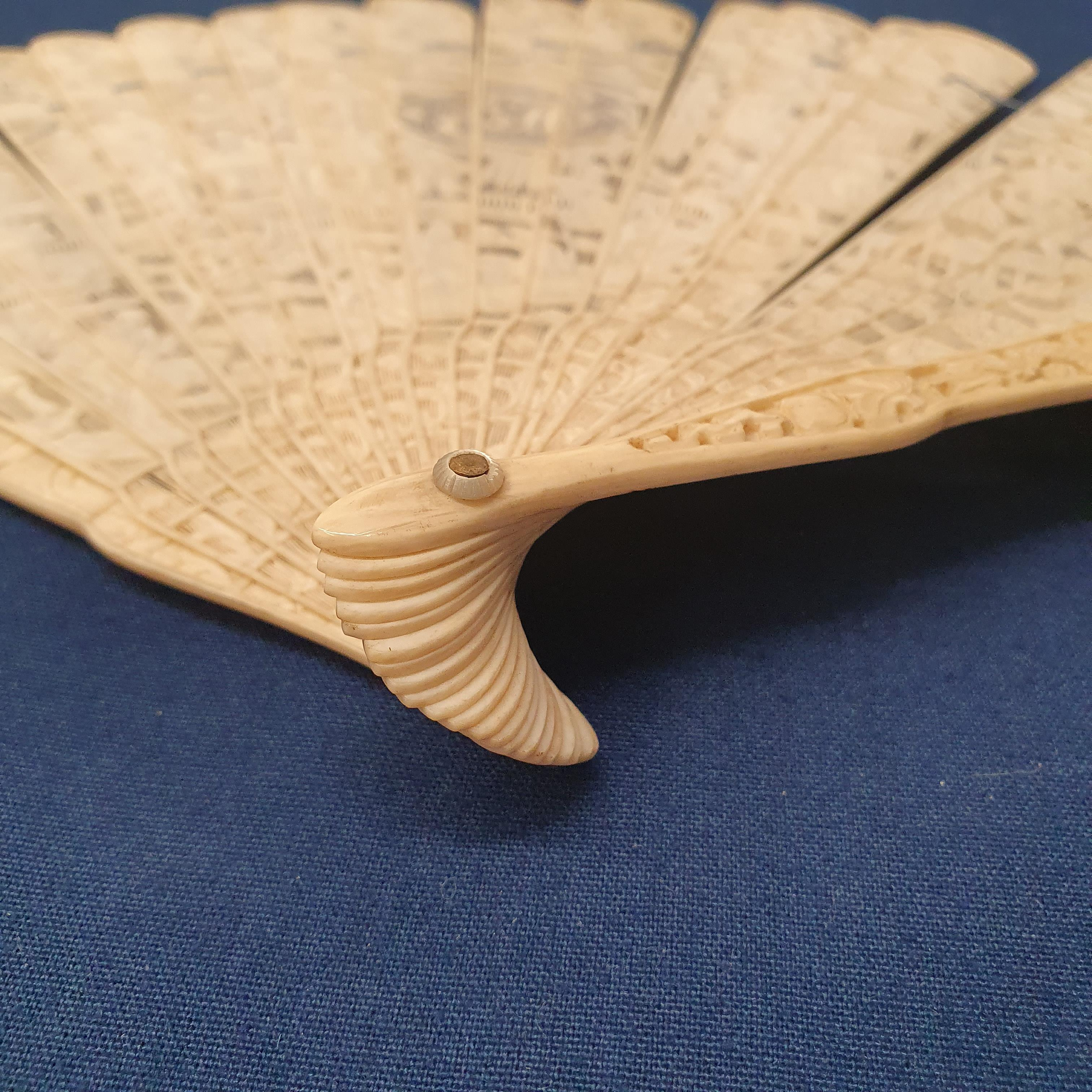 A Chinese ivory brisee fan, two others, and a similar fan with silk embroidered decoration, in a - Image 29 of 47