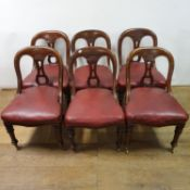A set of six 19th century mahogany hoop back dining chairs, with padded seats on turned tapering