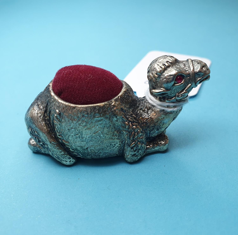 A silver plated camel pincushion