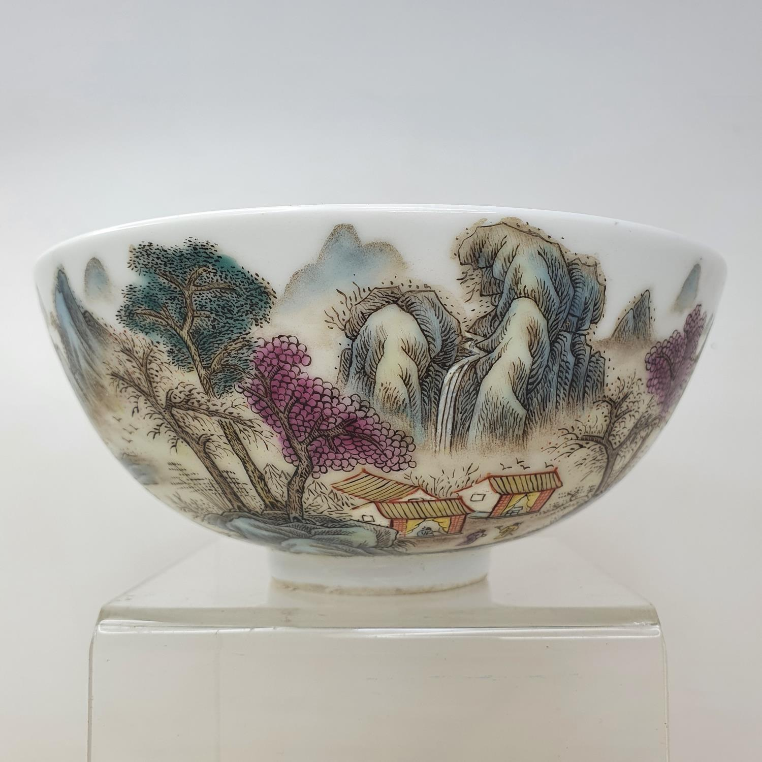 A Chinese porcelain bowl, decorated a mountainous landscape with figures and buildings, six