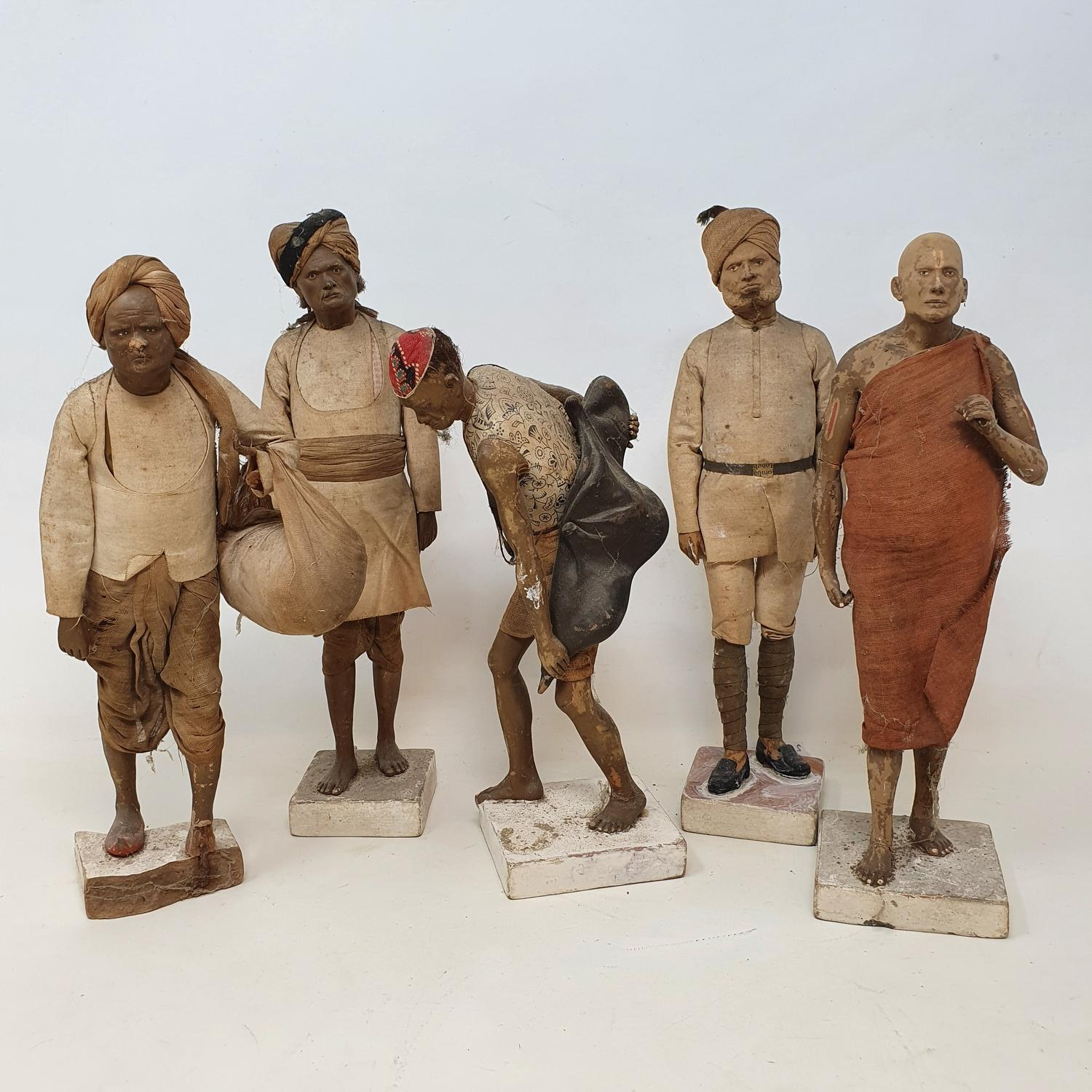 A set of five Indian composition figures, 23 cm high, and other figures (box)