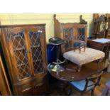 A modern oak corner cupboard, an adjustable stool, two footstools, an oak wall shelf, an oak