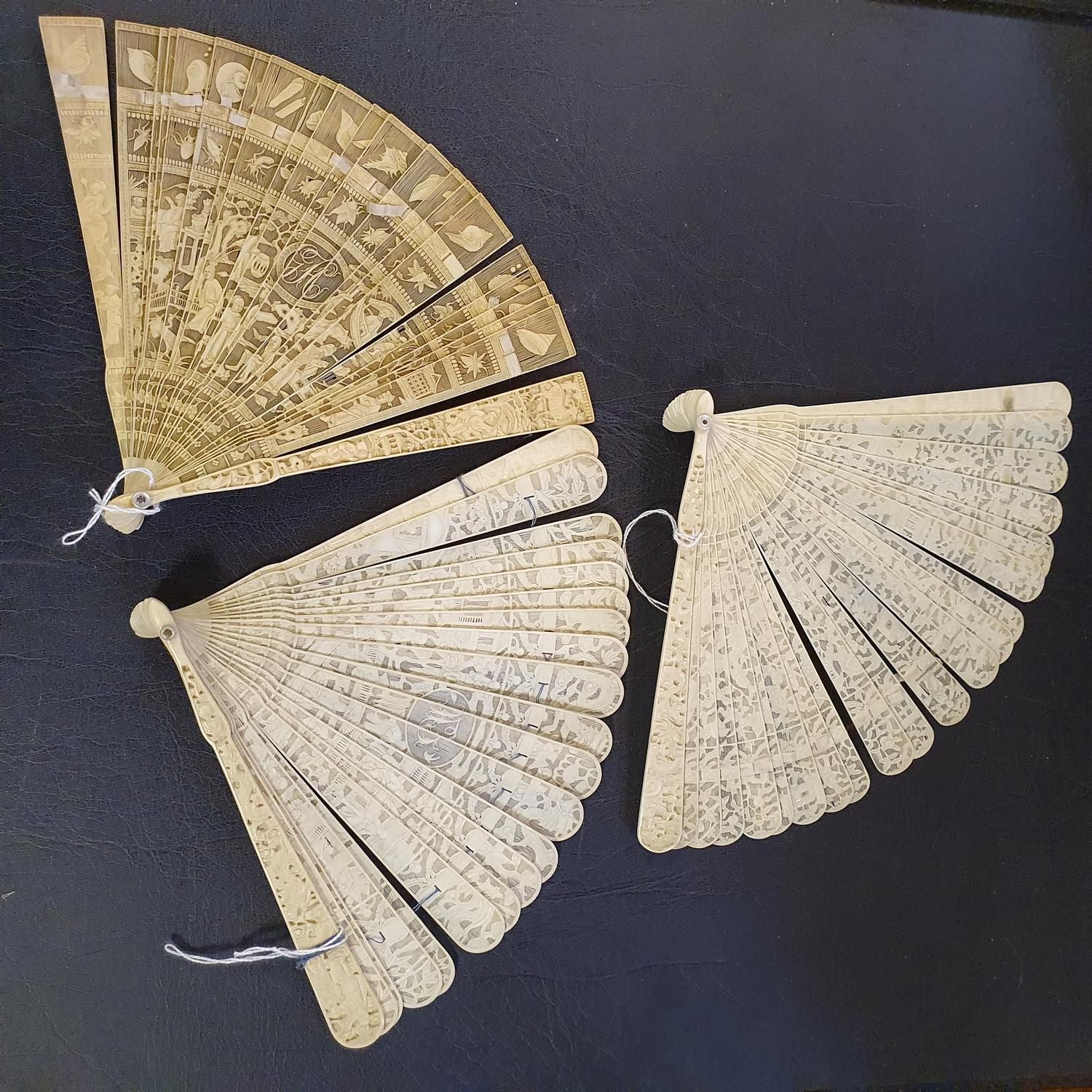 A Chinese ivory brisee fan, two others, and a similar fan with silk embroidered decoration, in a - Image 2 of 47
