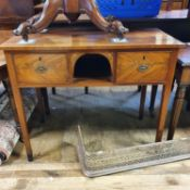 A 19th century mahogany side table, with an open section, flanked by two drawers, on square tapering