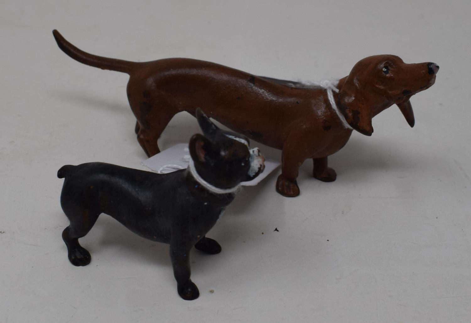 A modern painted metal figure of a French bulldog, 5 cm high, and another of a sausage dog (2)