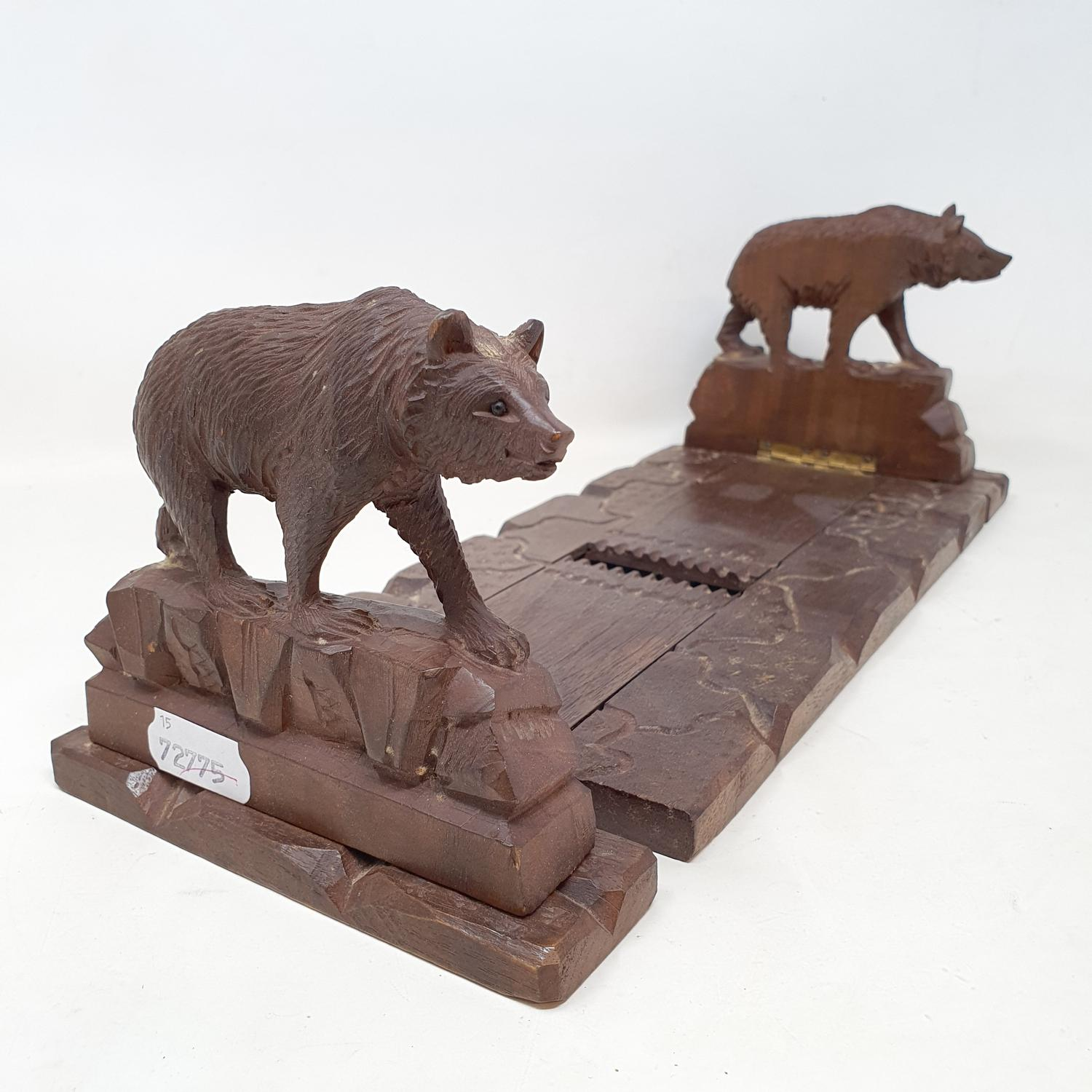 A late 19th/early 20th century Black Forest expanding book trough, carved bears, 43 cm wide (