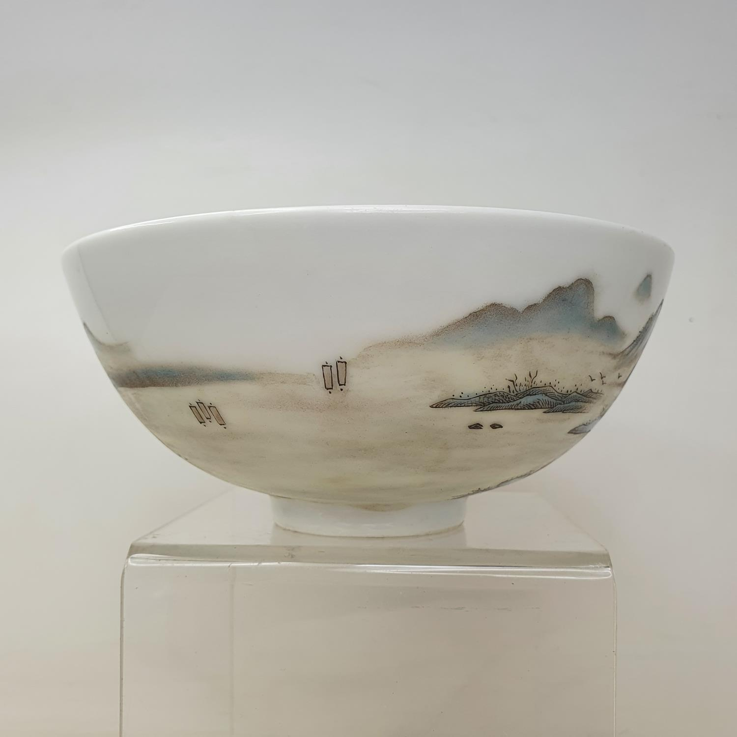 A Chinese porcelain bowl, decorated a mountainous landscape with figures and buildings, six - Image 2 of 7