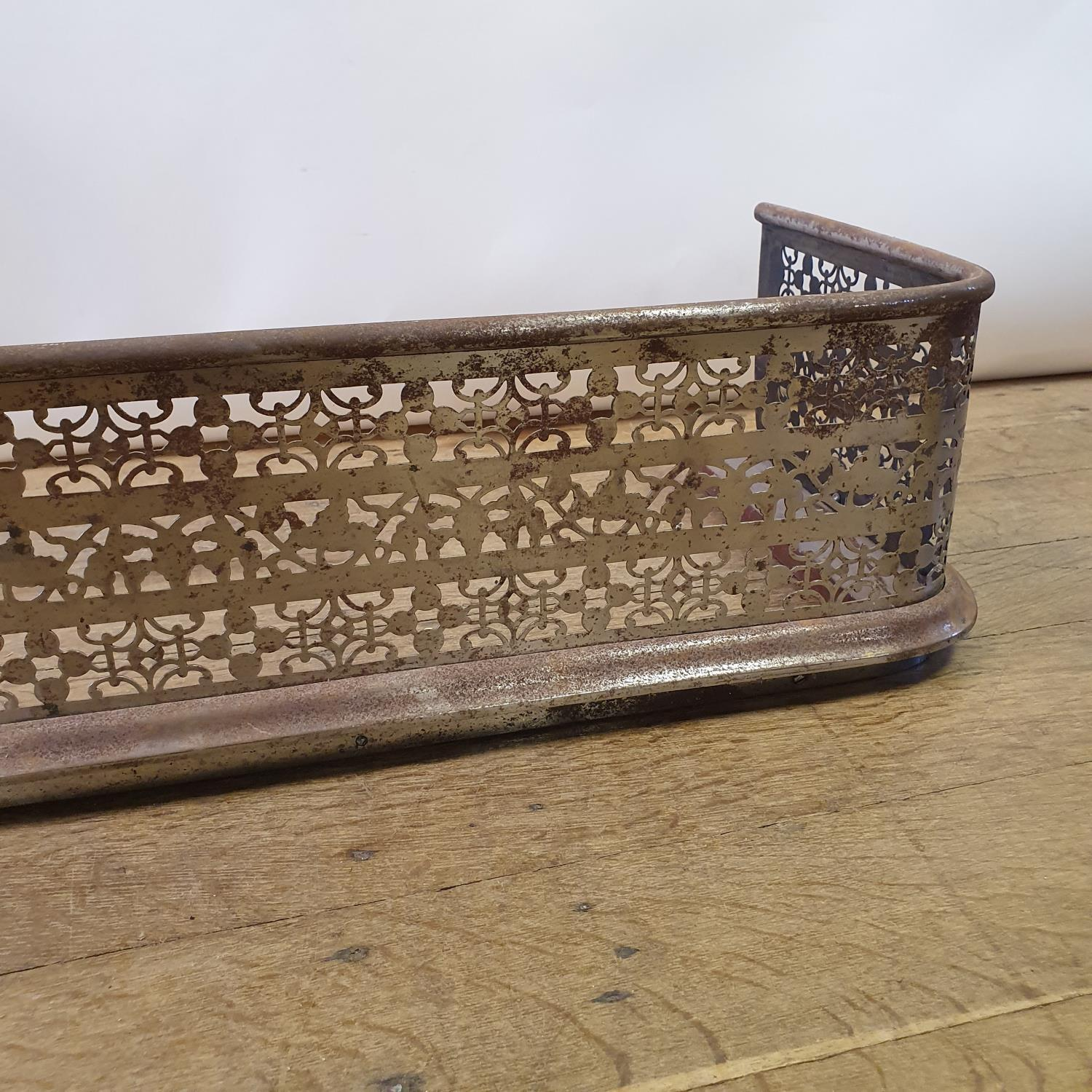 A 19th century cast iron fender, with pierced decoration, 134 cm wide - Image 2 of 2