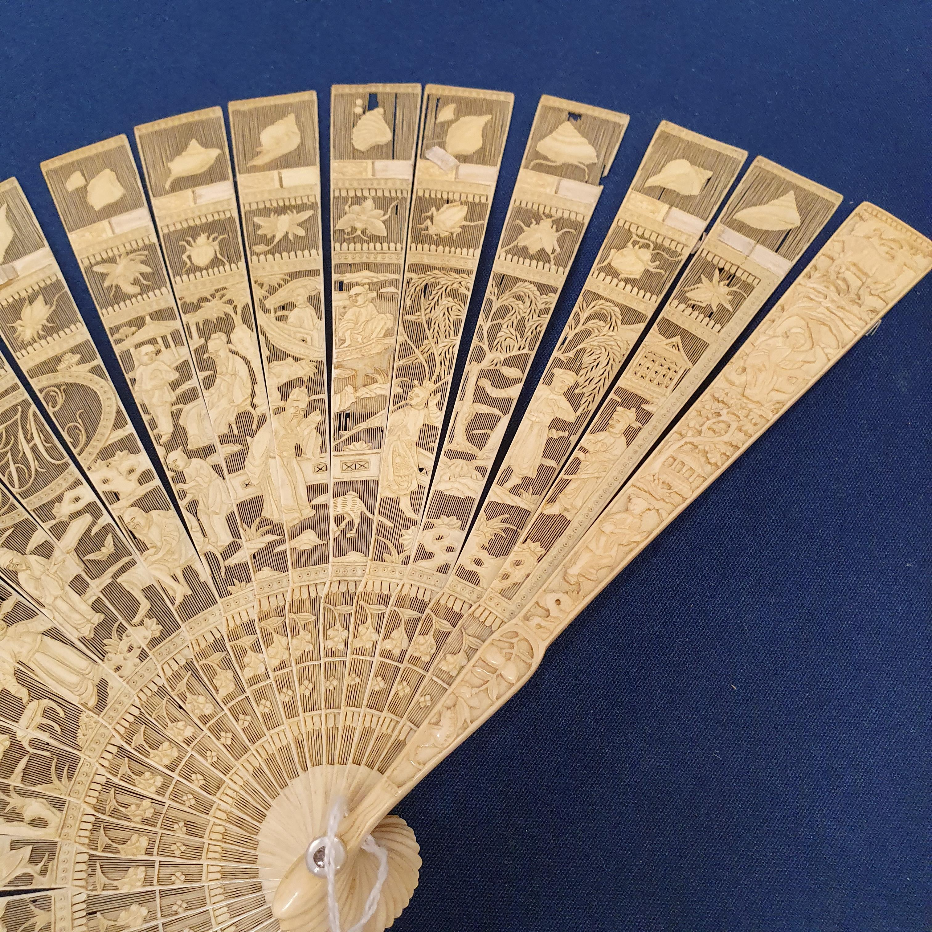 A Chinese ivory brisee fan, two others, and a similar fan with silk embroidered decoration, in a - Image 9 of 47