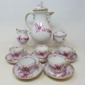 A Meissen porcelain coffee set, decorated flowers, highlighted in gilt, comprising a coffee pot,