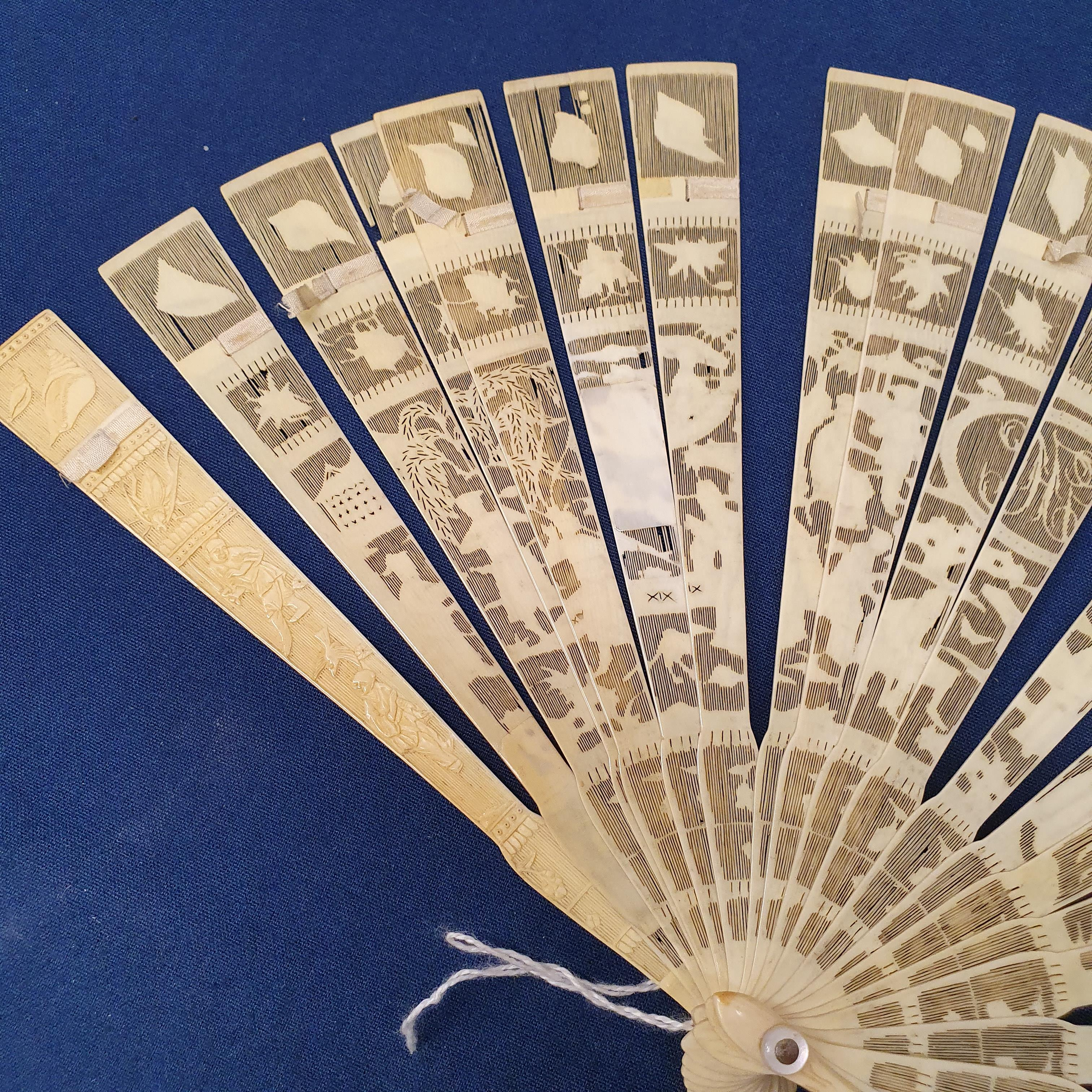 A Chinese ivory brisee fan, two others, and a similar fan with silk embroidered decoration, in a - Image 21 of 47