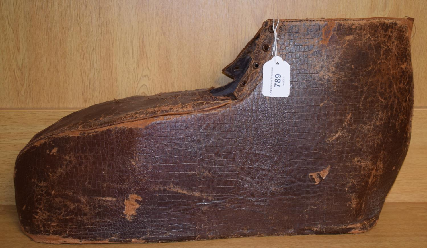 A 19th century large leather gout boot, 54 cm wide