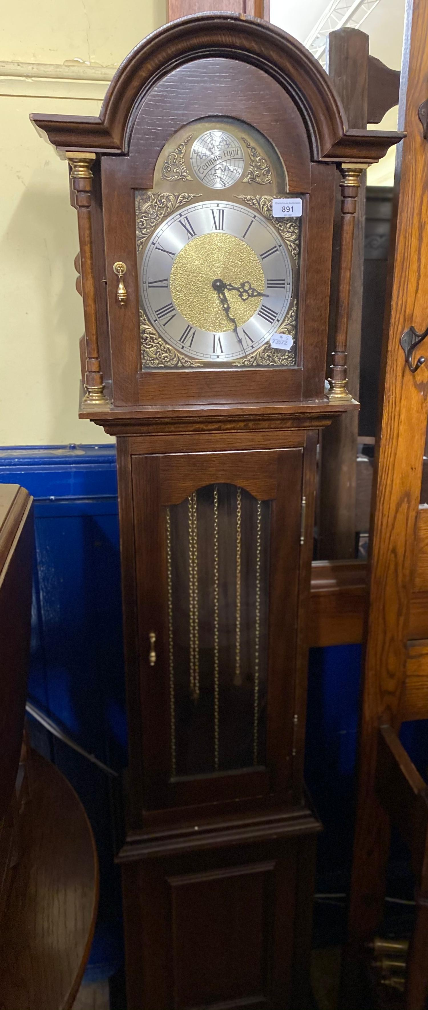 A modern longcase clock, in an oak case, 180 cm high