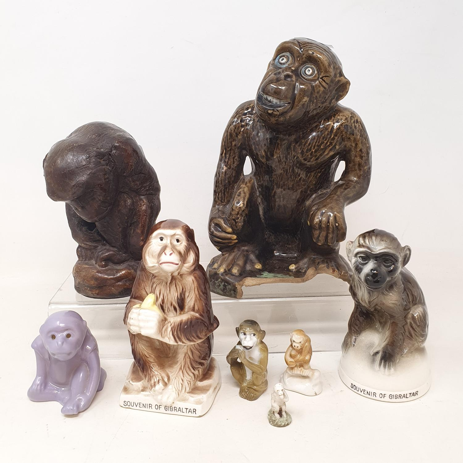 A pottery figure of a monkey, 17 cm, and seven others (8)