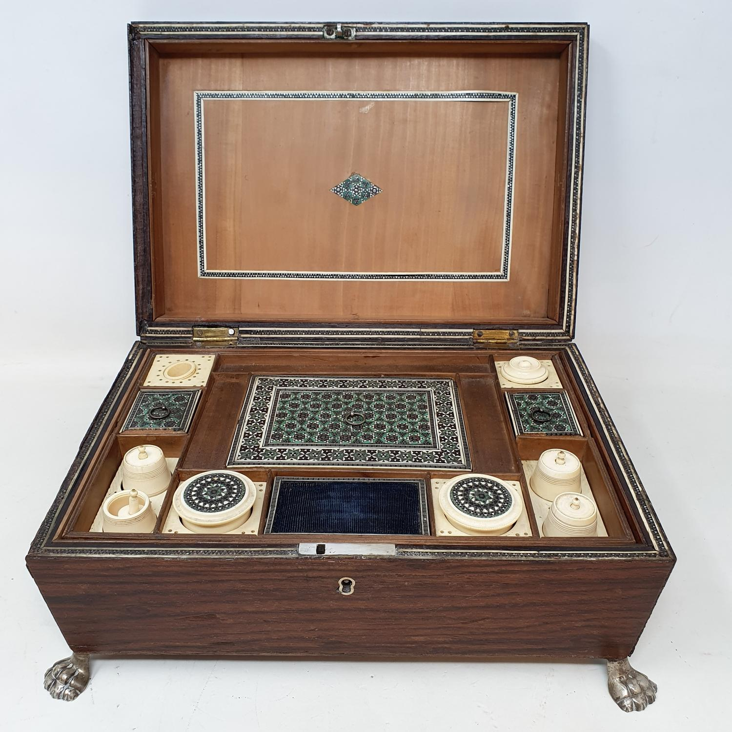 A 19th century rosewood sewing box,the fitted interior with various bone compartments, 26 cm wide