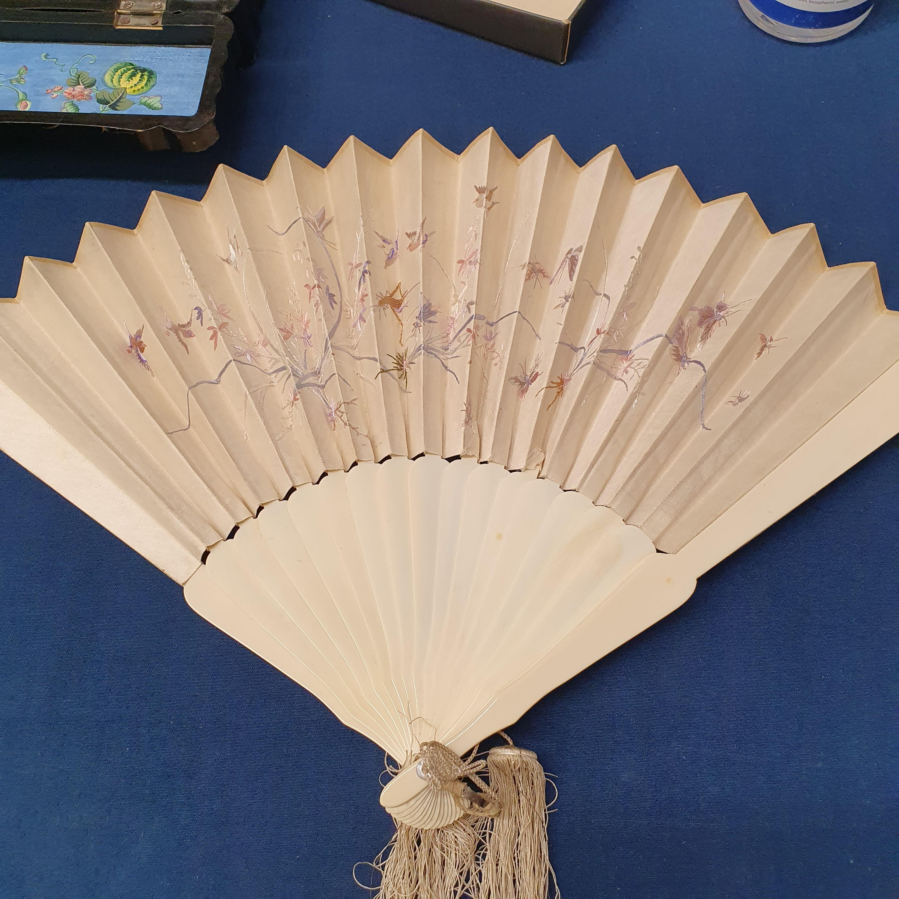 A Chinese ivory brisee fan, two others, and a similar fan with silk embroidered decoration, in a - Image 46 of 47