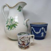 A Wedgwood Jasperware planter, 19 cm diameter, a Victorian water jug, a figure of a gentleman