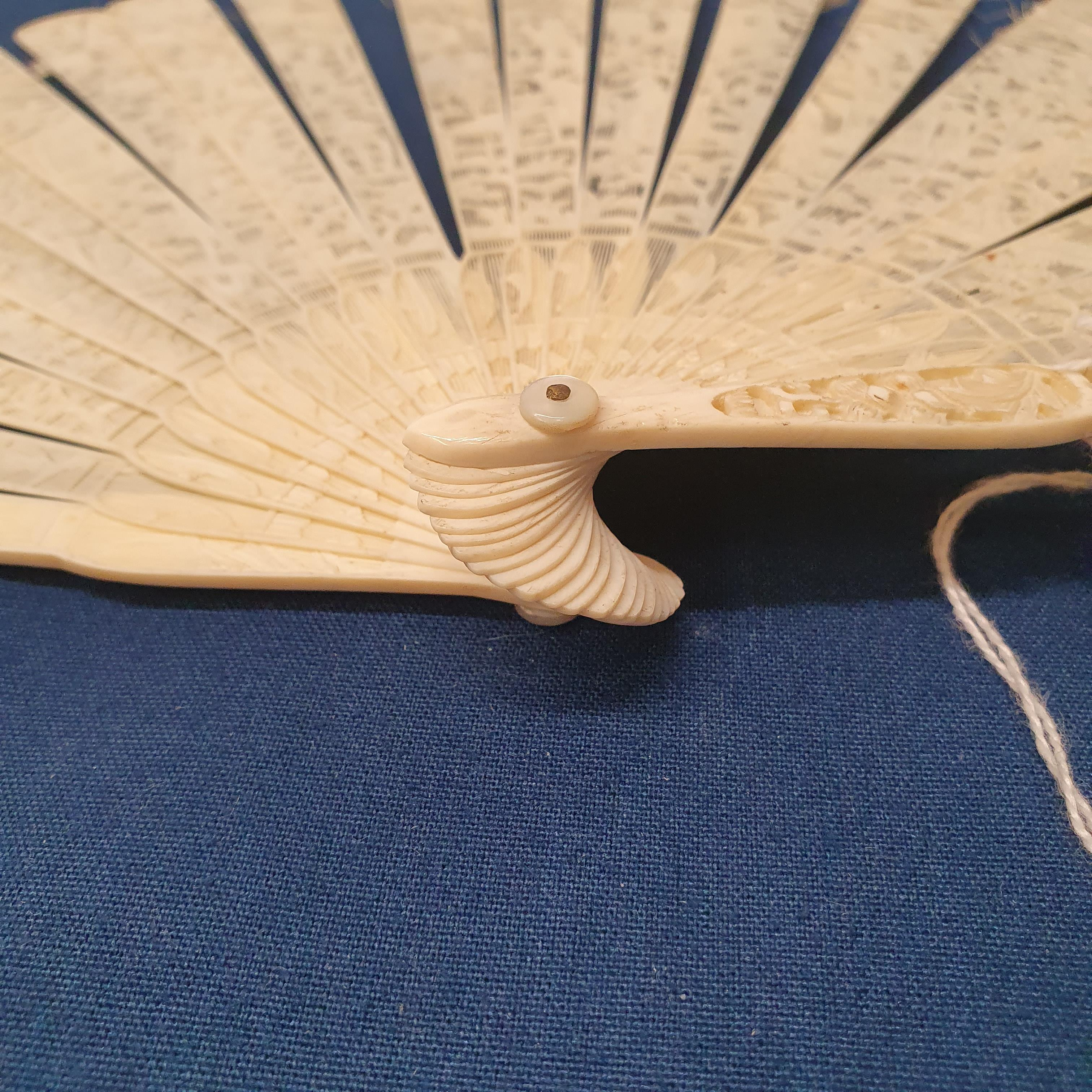A Chinese ivory brisee fan, two others, and a similar fan with silk embroidered decoration, in a - Image 39 of 47