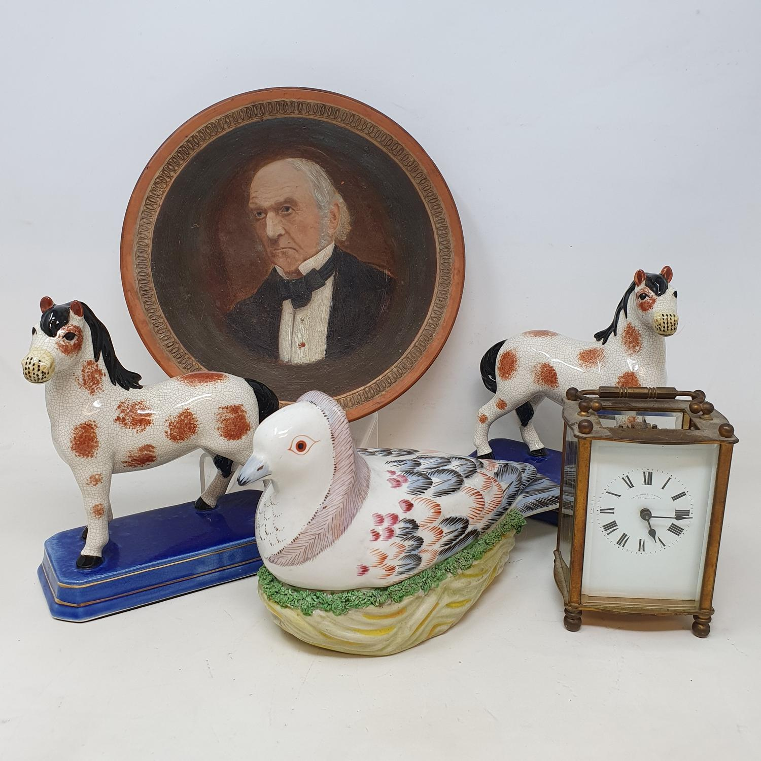 A Watcombe style terracotta plate, painted a gentleman, other ceramics and a carriage clock (2