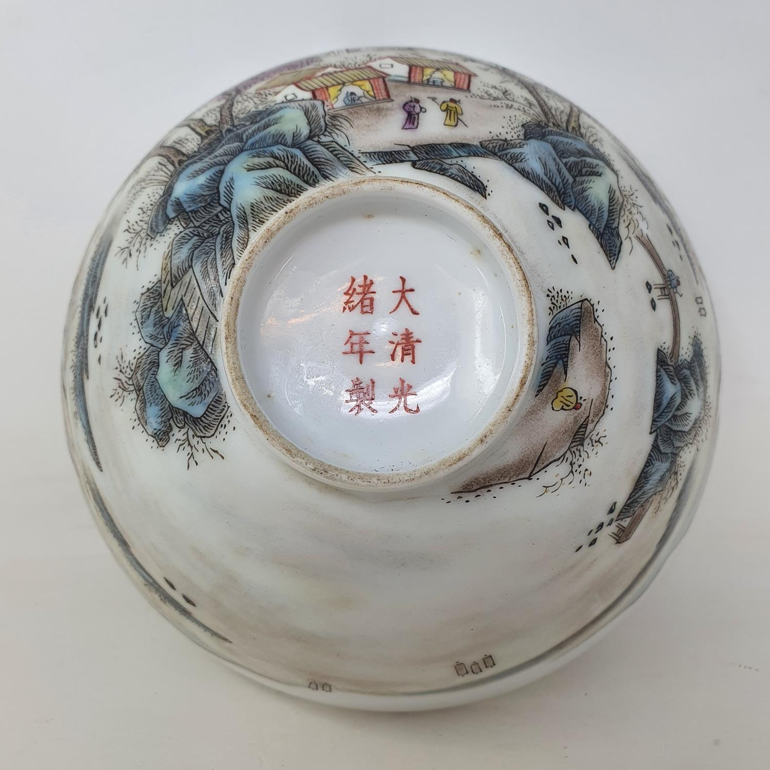 A Chinese porcelain bowl, decorated a mountainous landscape with figures and buildings, six - Image 6 of 7