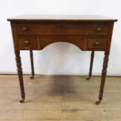 A 19th century mahogany kneehole dressing table, on turned tapering legs, 81 cm wide
