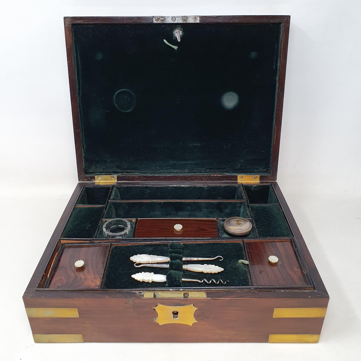 A 19th century mahogany and brass bound jewellery box, with a fitted interior, 30 cm wide