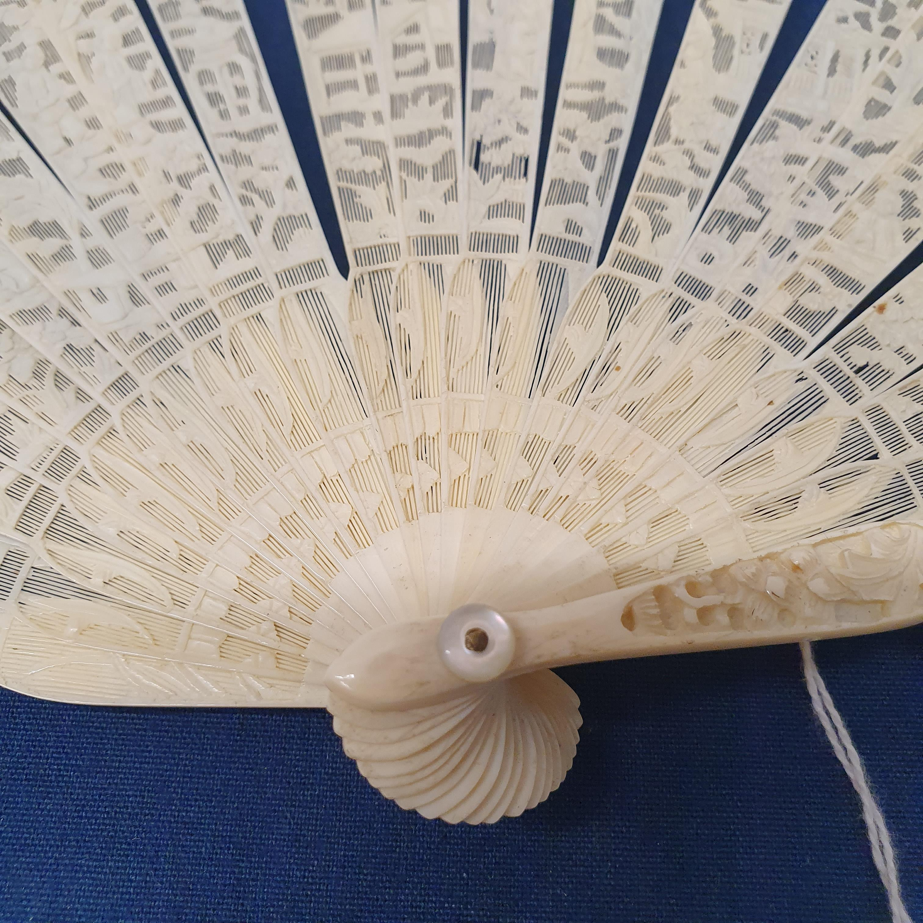A Chinese ivory brisee fan, two others, and a similar fan with silk embroidered decoration, in a - Image 40 of 47