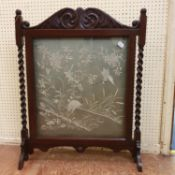 A Japanese needlework panel, decorated a heron, 52 x 54 cm, set in an oak firescreen