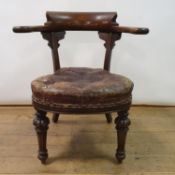 A 19th century mahogany armchair, with leather padded seat, on carved turned tapering legs