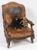 A 19th century large mahogany and leather armchair, on carved cabriole legs