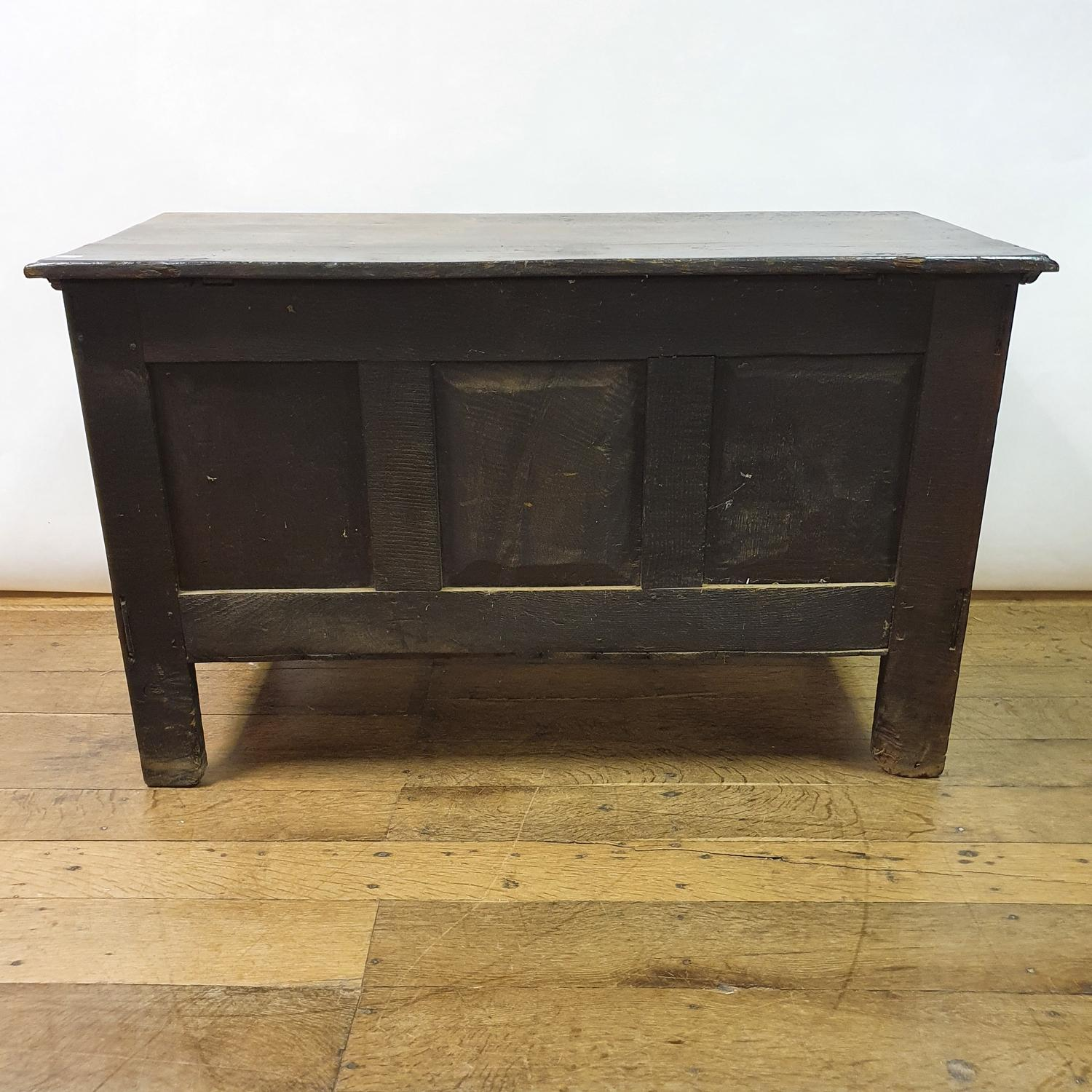 An 18th century oak coffer, with later carved decoration, 123 cm wide - Image 5 of 5