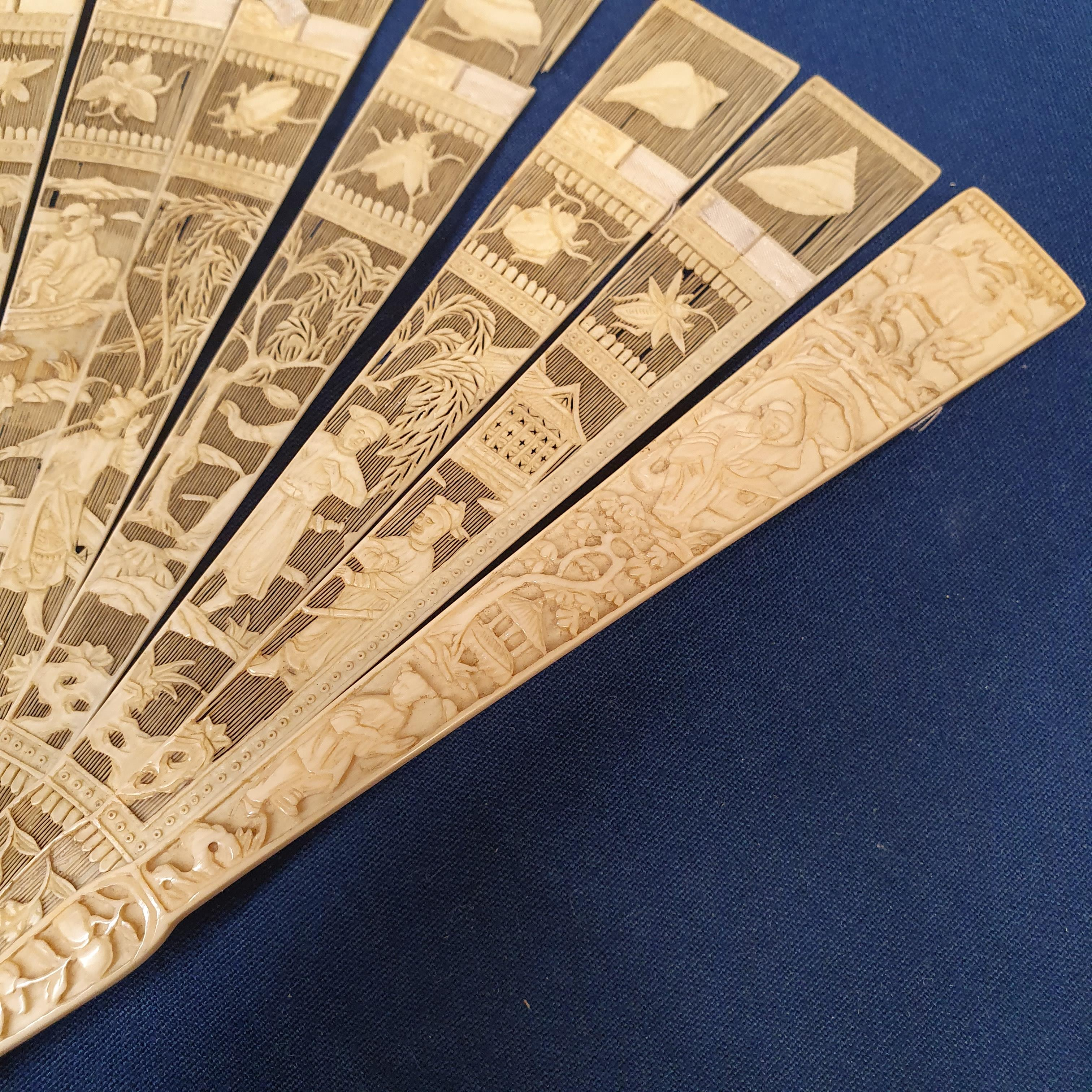 A Chinese ivory brisee fan, two others, and a similar fan with silk embroidered decoration, in a - Image 14 of 47