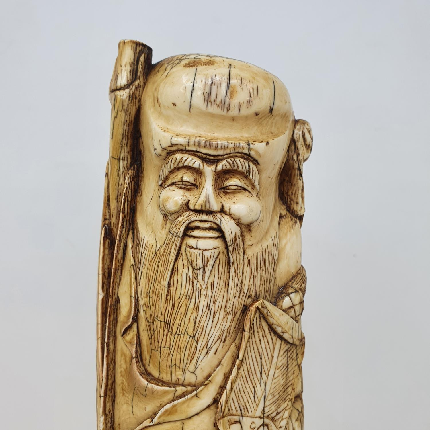 An early 20th century Chinese ivory tusk, carved in the form of Shou Lao, 28 cm high - Image 5 of 5