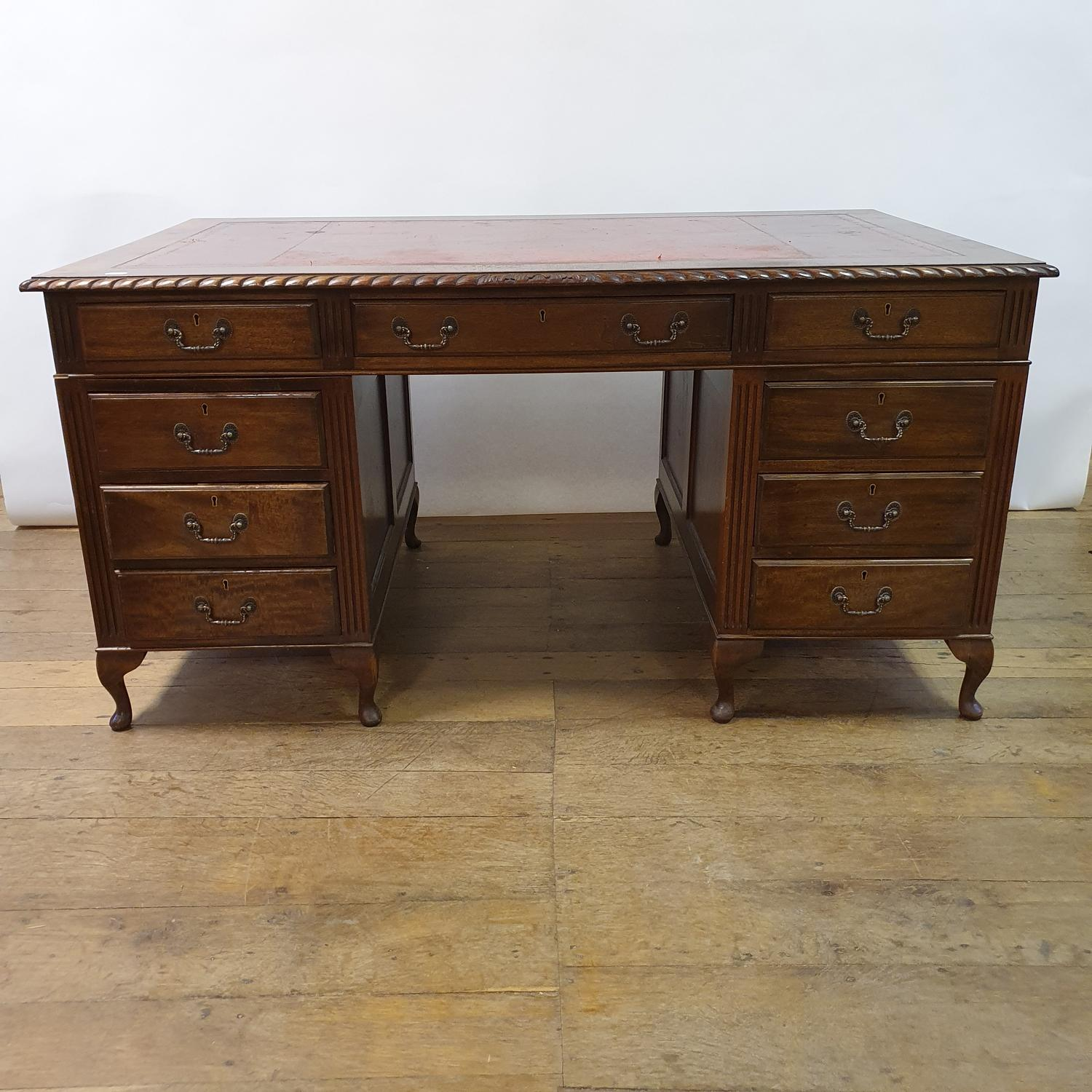 A mahogany pedestal desk, the leather inset top above an arrangement of nine drawers, on dwarf - Image 2 of 5