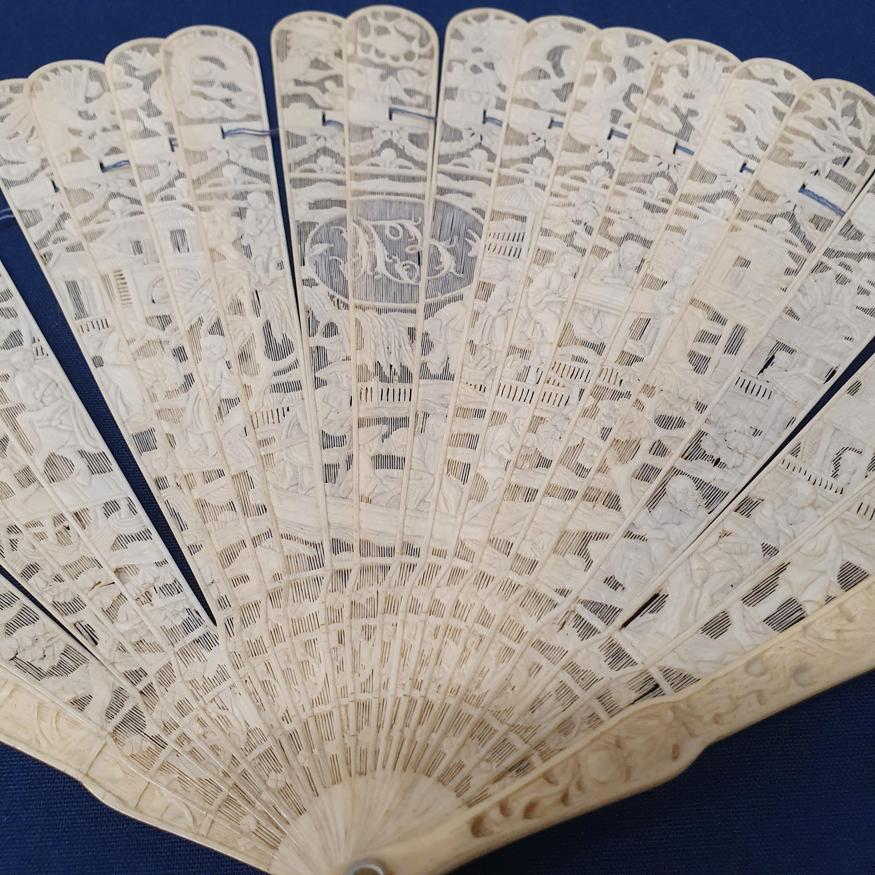 A Chinese ivory brisee fan, two others, and a similar fan with silk embroidered decoration, in a - Image 33 of 47