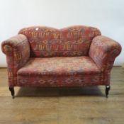 A sofa, on mahogany cabriole legs, 145 cm wide