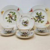 A set of three Meissen cups and saucers, decorated birds and butterflies, cross sword marks and