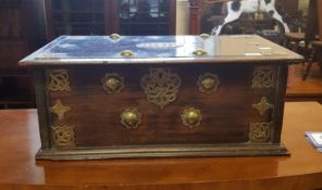 An 18th century Eastern hardwood and brass bound chest, 66 cm wide