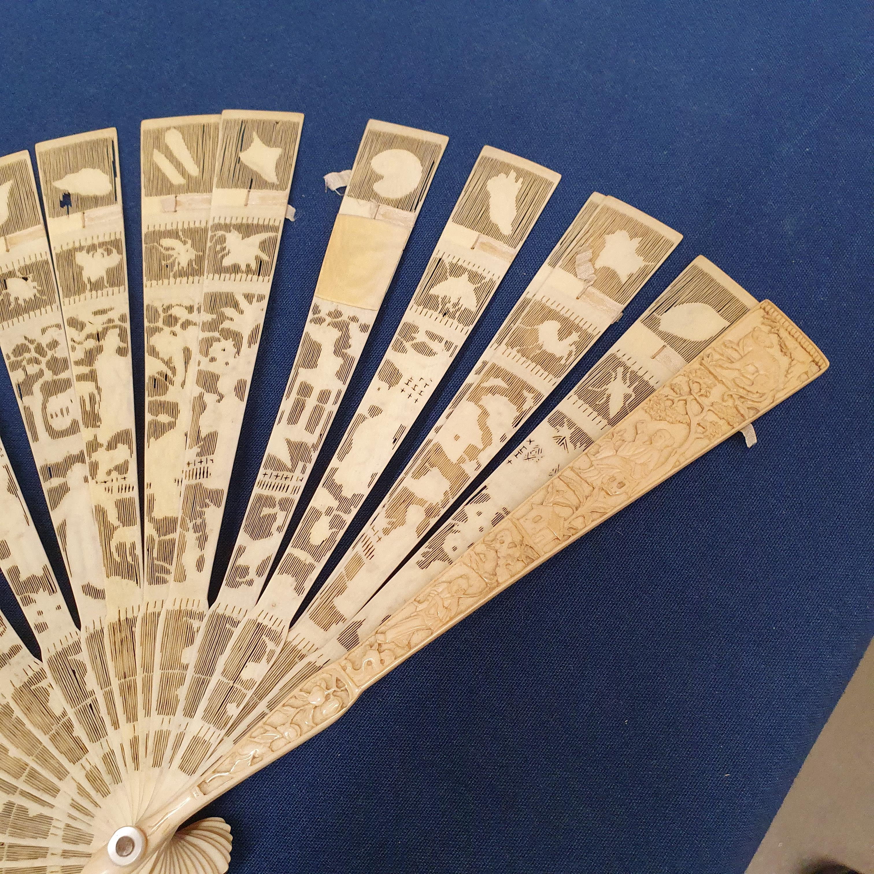 A Chinese ivory brisee fan, two others, and a similar fan with silk embroidered decoration, in a - Image 23 of 47
