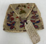 A late 18th/early 19th century embroidered purse, decorated birds and flowers, 12 cm wide