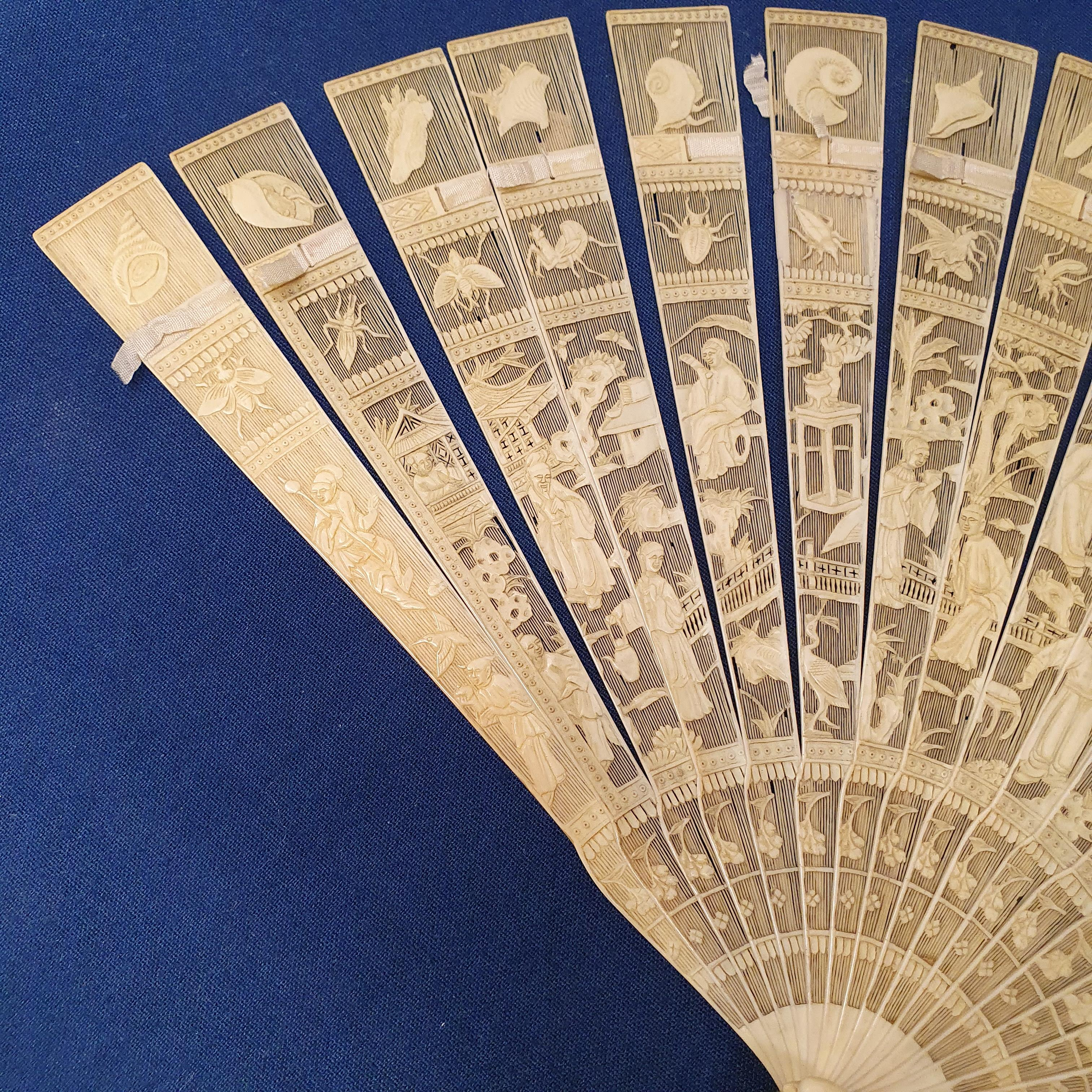 A Chinese ivory brisee fan, two others, and a similar fan with silk embroidered decoration, in a - Image 7 of 47
