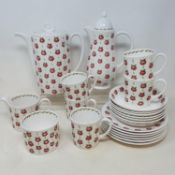 A Susie Cooper coffee set, a German porcelain tea set, assorted figures, other ceramics and