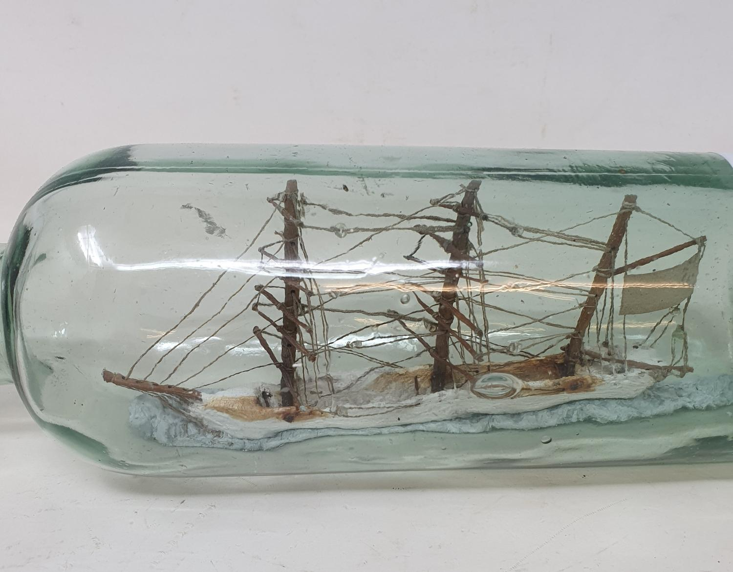 A ship in a bottle, 31 cm wide - Image 2 of 2
