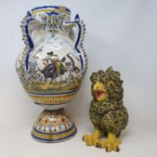 A Spanish tin glazed vase, decorated figures bull fighting, chipped, cracked and repaired, 41.5 cm