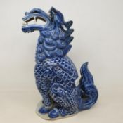 A Chinese blue and white figure of a dragon, 30 cm high slight loss